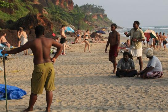 Indian men ogle Western women on a beach in Varkala, India.