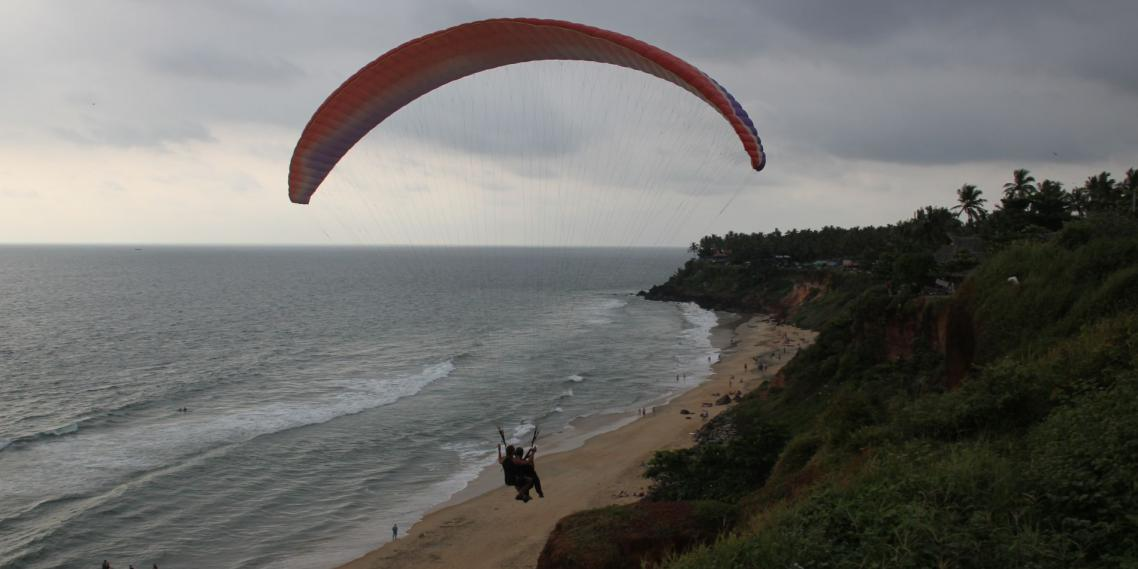 A paraglider takes a tourist flying above the Arabian Sea in Varkala, India.