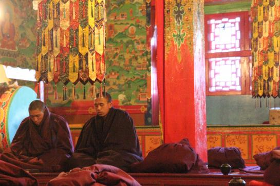 Monks meditate in the monastery in Tengboche, Nepal.
