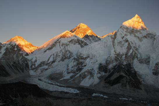 Sunlight illuminates Mount Everest during a sunset seen from Kala Patthar, Nepal.