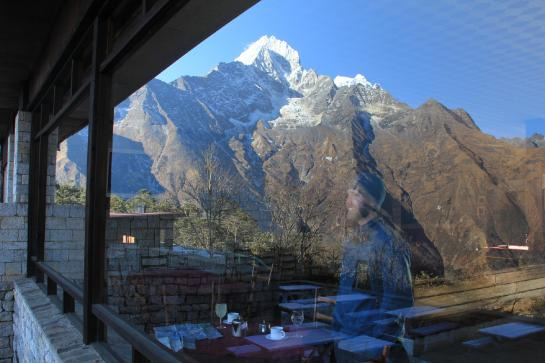 Brian gazes at Mount Everest through the window of the Hotel Everest View above Namche Bazaar, Nepal.