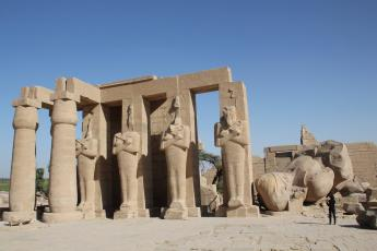Ramesseum First Pylon with fallen Ramses colossus head