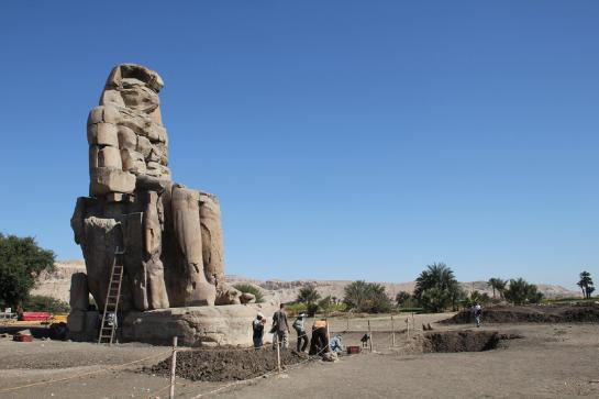 Restorationists work on one of the Colossi of Memnon at the entrance to the Theban Necropolis.