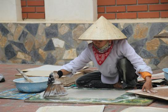 A woman makes paper by hand in Dong Ho, Vietnam.