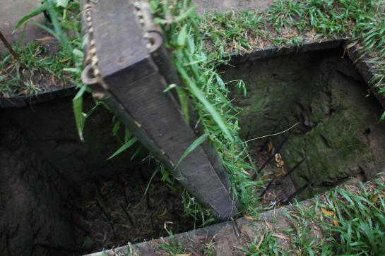 A spike trap lies underground at Vietnam's Cu Chi Tunnels.