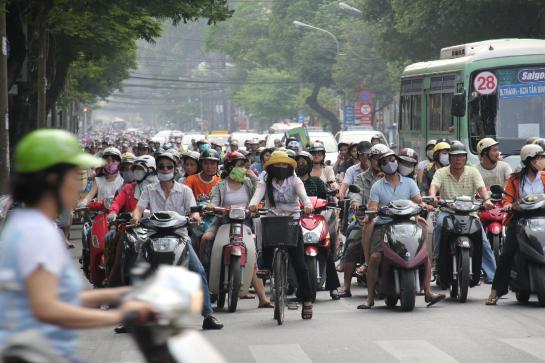"The ""economic miracle"" of capitalism has deeply infiltrated Ho Chi Minh City, Vietnam, where most own a motorized scooter."