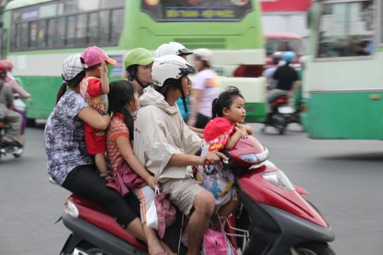 A five-person Vietnamese family squeezes on to a motorcycle in Ho Chi Minh City, Vietnam.