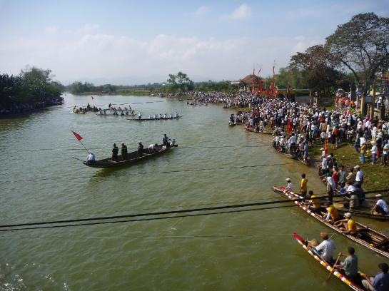 Paddle boats representing nearby towns race against each other on the Perfume River near Hue, Vietnam.