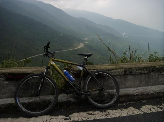 A bicycle sits on the road on Vietnam's Hai Van Pass.