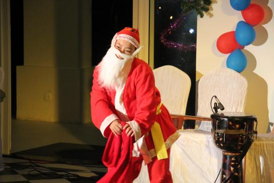 A Vietnamese boy dons a Santa Claus suit in a Christmas pageant in Hoi An, Vietnam.