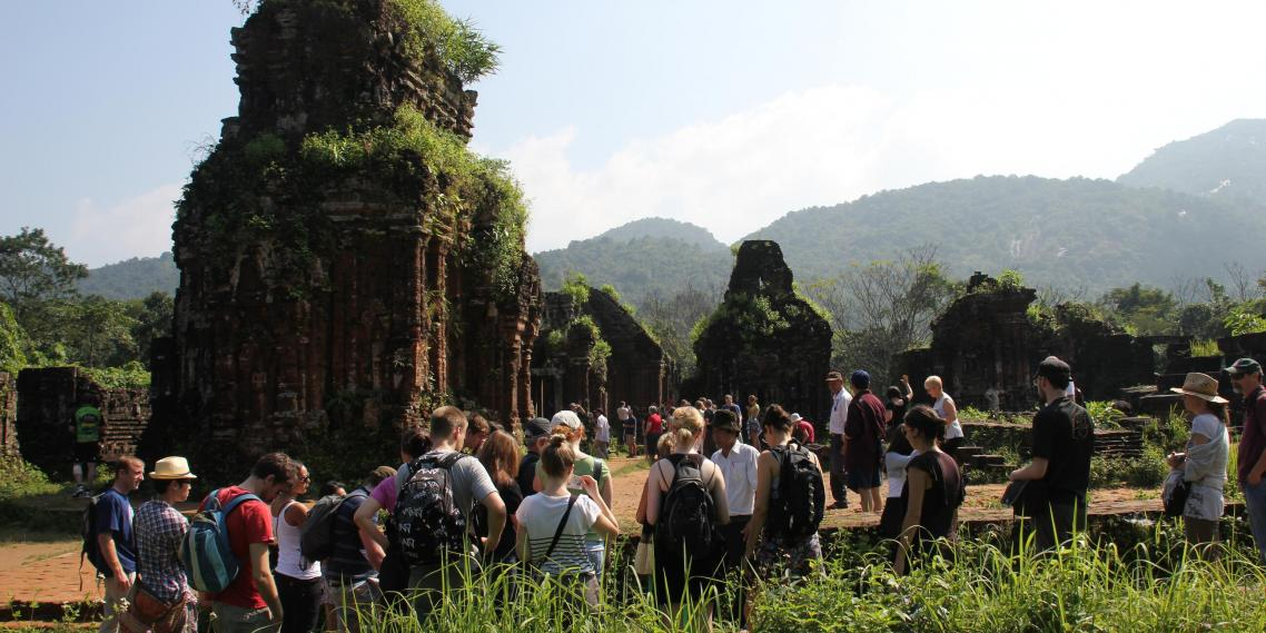 Tourists explore the ancient My Son Temple Complex near Hoi An, Vietnam.