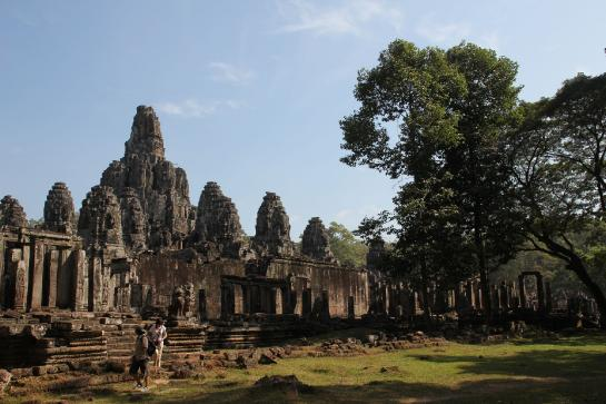 Hundreds of stone faces watch over visitors to the Bayon temple in Angkor Thom.