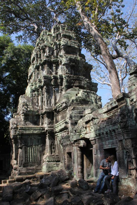 A couple kisses in Ta Prohm.