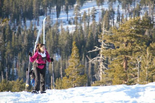 A hiker snowshoes up Horizon Ridge.