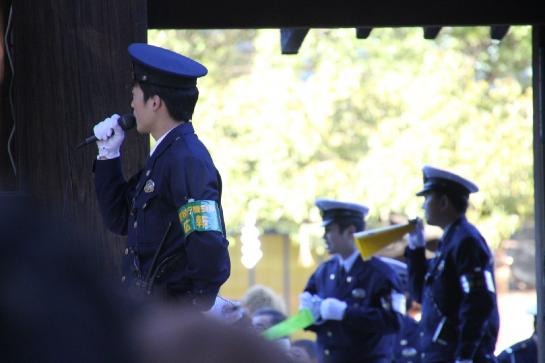 Japanese police manage the Meiji Jingu Shrine's many visitors.