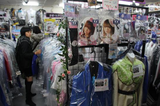 A cosplay girl browses for costumes on Otome Road in Tokyo, Japan.