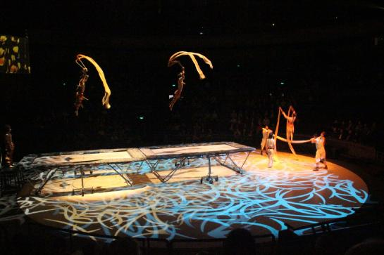 Chinese acrobats jump on trampolines at Shanghai Circus World.