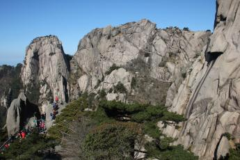 Chinese tour groups hike up stairs on China's Huangshan (Yellow Mountain).
