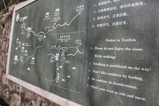 "A sign warns Huangshan hikers to ""not enjoy the views while walking."""