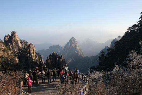 Chinese tourists admire a view near the summit of Huangshan.