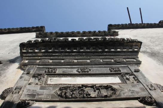 Stone carvings greet visitors at the entrance of Xidi's Yingfu Hall.