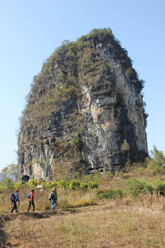 Climbers walking toward The Egg in Yángshuò, Guangxi, China.