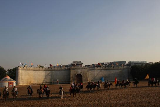 Actors perform a reenactment of a Ghenghis Khan horseback battle at Splendid China in Shenzhen.