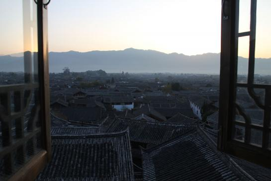 The rooftops of Lìjiāng, China, seen from a hotel room window.