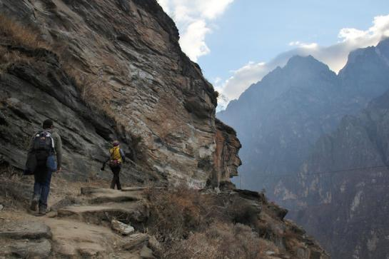 Hikers trek through China's Tiger Leaping Gorge.