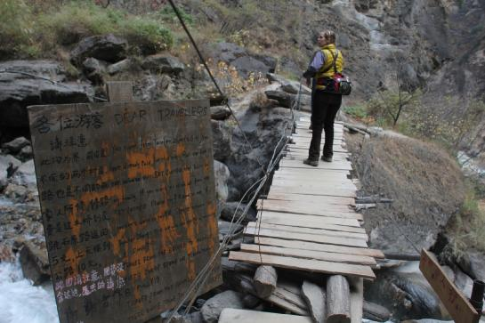 Illegal signs used to extort money from tourists dot the trail in China's Tiger Leaping Gorge.