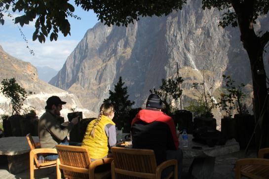 Hikers admire the view from the outdoor restaurant at Sean's Guest House in Walnut Garden, China.