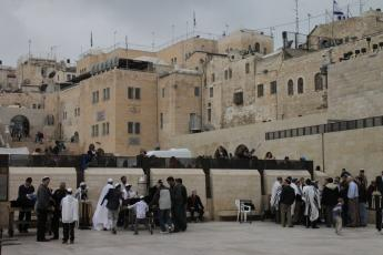 Men, separated from women, take part in Bar Mitzvah ceremonies at the Wailing Wall in Jerusalem, Israel.