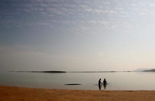 People swim at Ein Bokek's public beach on the Dead Sea in the West Bank near Jerusalem, Israel.