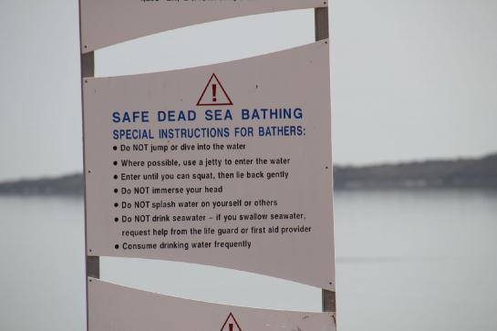 A sign near the Dead Sea warns swimmers of the dangers of the water's high salt content.