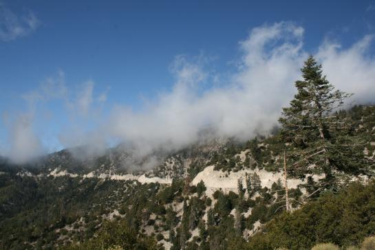 Clouds hover over the winding road to Big Bear Lake, California.