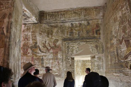 Tourists look at carvings in the Temple of Derr in Lower Nubia, Egypt.