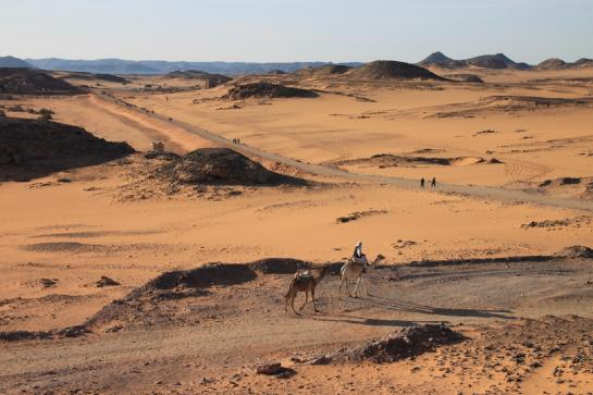 Tourists ride camels across the Nubian Desert near Wadi es-Sebua in Nubia, Egypt. (photo by Brian Leukart)