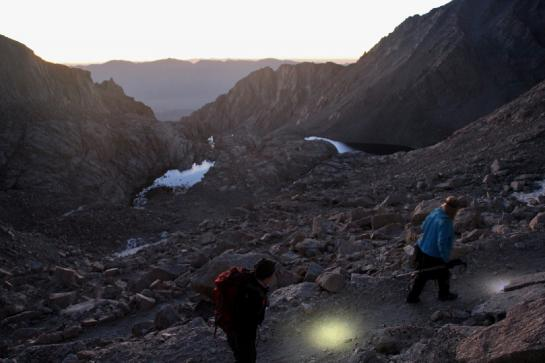 Backpackers hike up the Mount Whitney Trail's 99 switchbacks at sunrise.