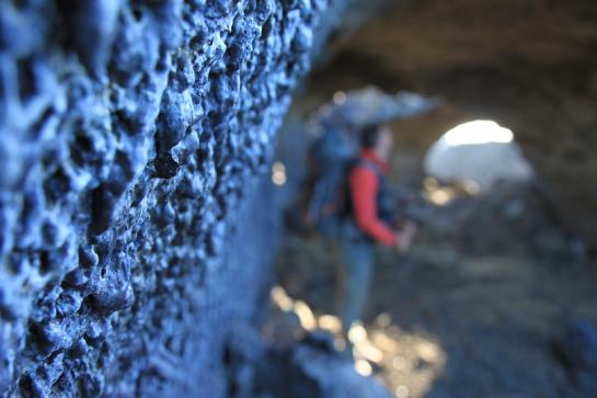 Hank investigates a lava tube near Krafla. (photo by Brian Leukart)