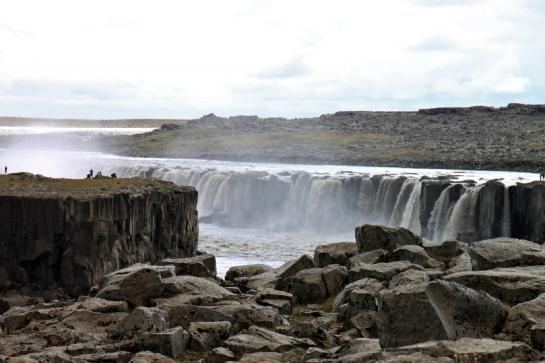 Tourists admire Selfoss Waterfall in Northern Iceland. (photo by Brian Leukart)