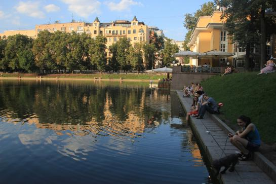 Russians relax on the shore of Moscow's famous Patriarshiye Pond.