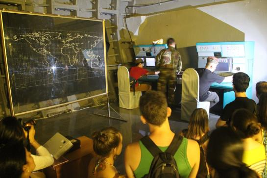 Tourists watch a nuclear war simulation in Moscow's Bunker 42.