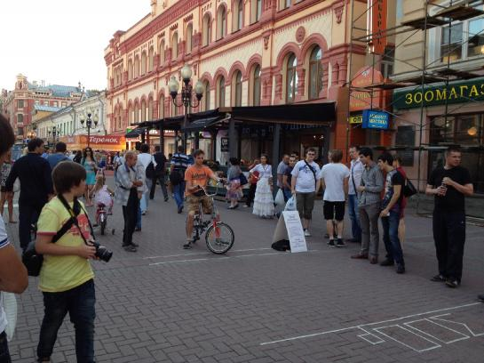 A performer rides a Wild Bike on Arbat Street in Moscow.