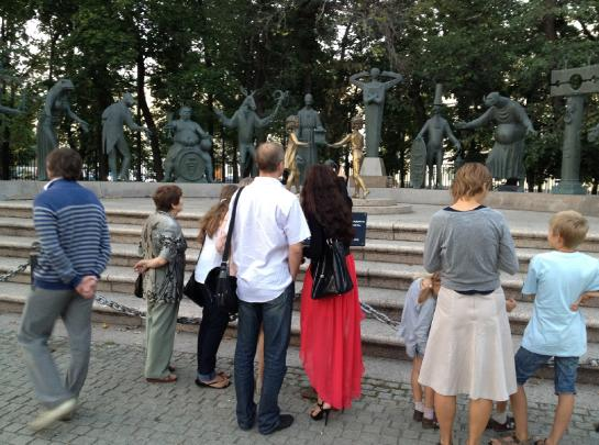 Tourists look at The Sins Monument in Bolotnaya Ploshchad in Moscow.