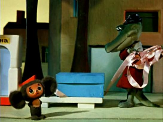 In an episode of the classic Russian animated series, Gena (the crocodile) opens a birthday gift from Cheburashka.