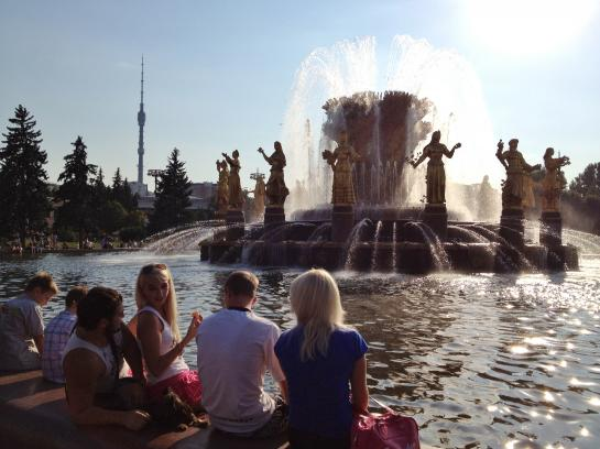 Muscovites sit on the edge of a fountain at the All-Russia Exhibition Centre (VVC).