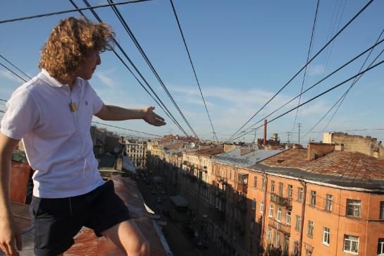 Tour guide Seva describes the view from a rooftop in St. Petersburg, Russia.