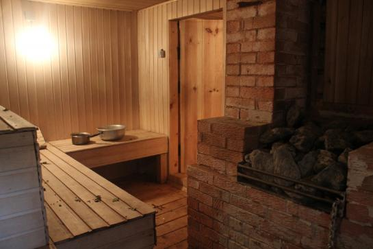 Inside a Russian banya, wooden benches wait for bathers.
