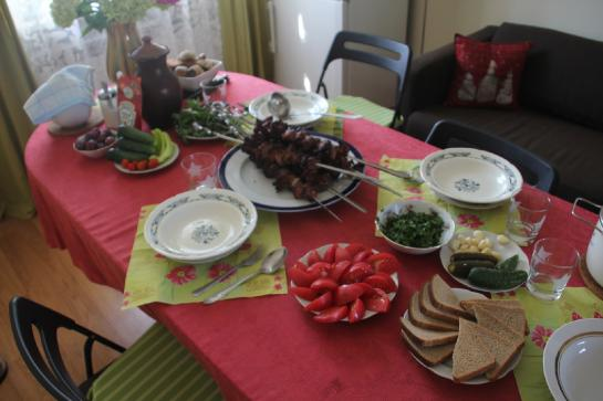 A Russian feast with shashlik waits to be eaten.