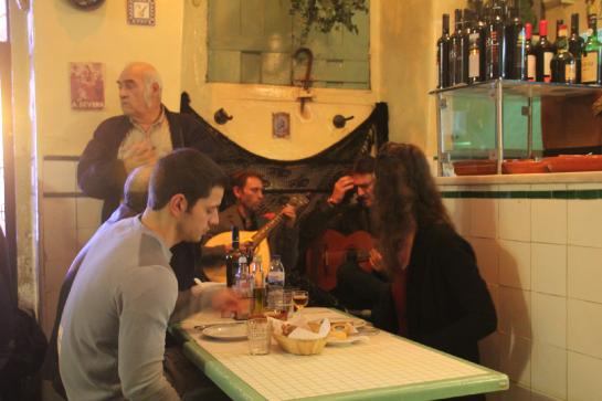 Fado musicians perform in the A Baiuca restaurant in Lisbon's Alfama.